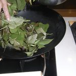 Put leaves into hot oil